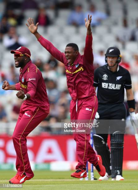 Sheldon Cottrell of West Indies appeals successfully alongside Ashley Nurse for the lbw wicket of Martin Guptill of New Zealand during the Group...