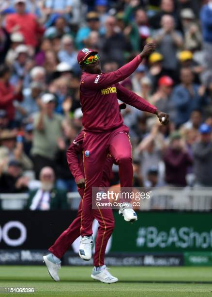 Sheldon Cottrell of West Indies celebrates after taking a catch to dismiss Steve Smith of Australia during the Group Stage match of the ICC Cricket...
