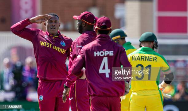 Sheldon Cottrell of West Indies celebrates after taking the wicket of David Warner of Australia during the Group Stage match of the ICC Cricket World...