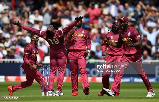 Sheldon Cottrell of West Indies celebrates after taking the wicket of Glenn Maxwell fo Australia during the Group Stage match of the ICC Cricket...