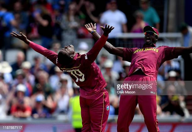 Sheldon Cottrell of West Indies celebrates bowling Colin Munro of New Zealand during the Group Stage match of the ICC Cricket World Cup 2019 between...