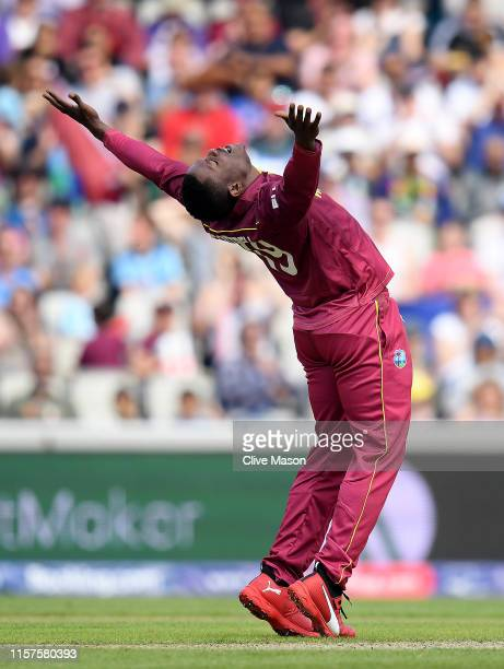 Sheldon Cottrell of West Indies celebrates dismissing Tom Latham of New Zealand caught and bowled during the Group Stage match of the ICC Cricket...