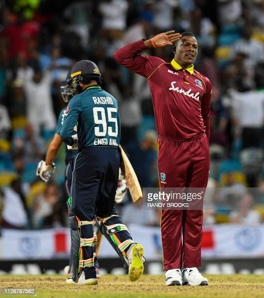 Sheldon Cottrell of West Indies celebrates the dismissal of Adil Rashid of England during the 2nd ODI between West Indies and England at Kensington...