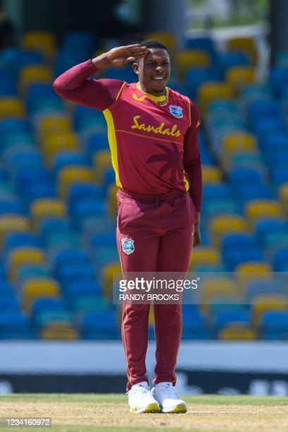 Sheldon Cottrell of West Indies celebrates the dismissal of Ben McDermott of Australia during the 2nd ODI between West Indies and Australia at...