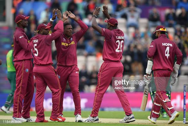 Sheldon Cottrell of West Indies celebrates the wicket of Hashim Amla of South Africa with his teammates during the Group Stage match of the ICC...