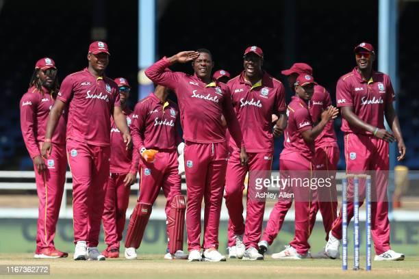 Sheldon Cottrell of West Indies celebrates the wicket of India's Shikhar Dhawan during the second MyTeam11 ODI between the West Indies and India at...