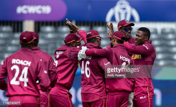 Sheldon Cottrell of West Indies celebrates with his team mates after taking the wicket of Martin Guptill of New Zealand during the ICC Cricket World...