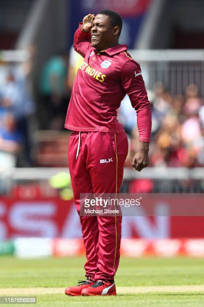 Sheldon Cottrell of West Indies dons his traditional salute after trapping Martin Guptill of New Zealand lbw during the Group Stage match of the ICC...