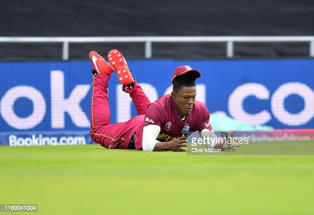Sheldon Cottrell of West Indies drops Rahmat Shah of Afghanistan during the Group Stage match of the ICC Cricket World Cup 2019 between Afghanistan...