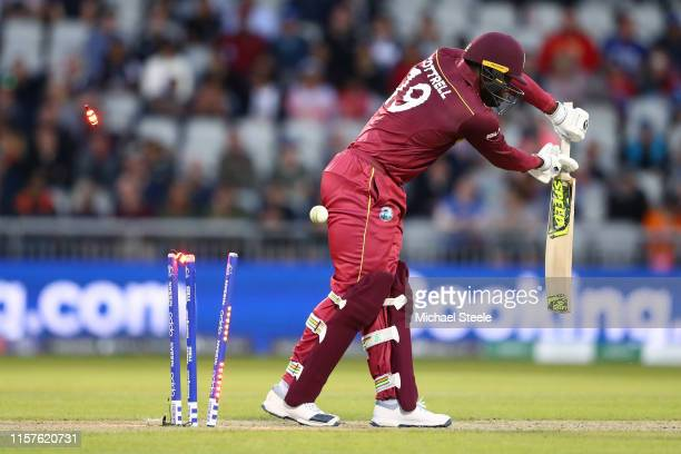 Sheldon Cottrell of West Indies is bowled by Lockie Ferguson of New Zealand during the Group Stage match of the ICC Cricket World Cup 2019 between...