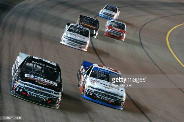 Sheldon Creed driver of the AM Ortega/United Rentals Chevrolet and Johnny Sauter driver of the ISM Connect Chevrolet lead a pack of trucks during the...