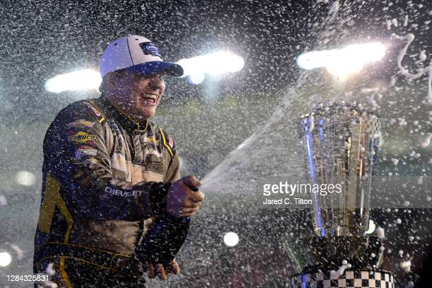 Sheldon Creed, driver of the Chevy Accessories/Trench Shoring Chevrolet, celebrates in victory lane after winning the NASCAR Gander RV & Outdoors...