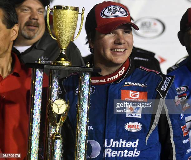 Sheldon Creed of Alpine CA driving a Toyota for United Rentals holds the winning trophy after winning the ARCA Racing Series PapaNicholas Coffee 150...
