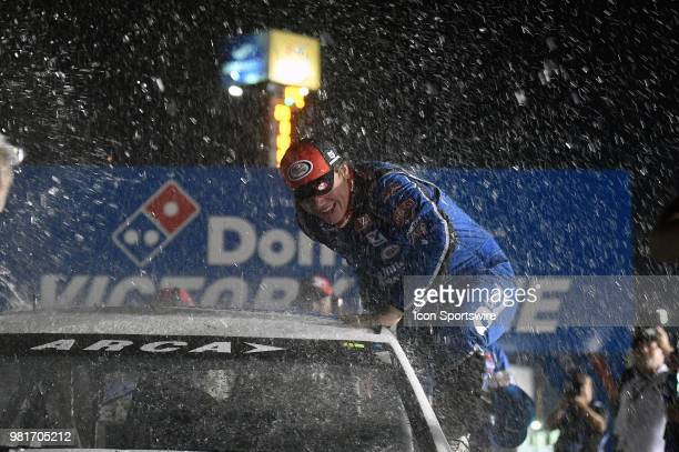 Sheldon Creed of Alpine CA driving a Toyota for United Rentals is showered with water and confetti as he climbs out of his winning race car after...