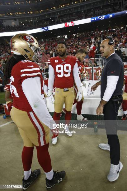 Sheldon Day DeForest Buckner and Defensive Coordinator Robert Saleh of the San Francisco 49ers talk on the sideline during the game against the Los...