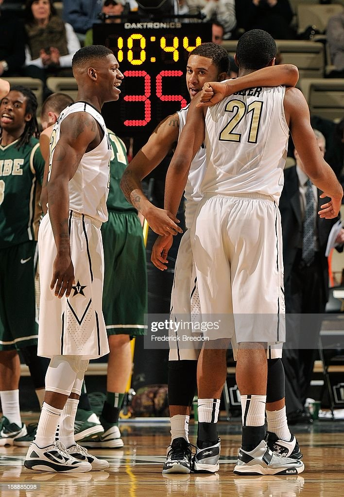 Sheldon Jeter #21 of the Vanderbilt Commodores is hugged by teammate Kedren Johnson #2 during a game against William & Mary at Memorial Gym on January 2, 2013 in Nashville, Tennessee.