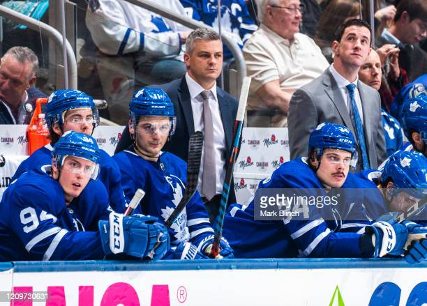 Sheldon Keefe head coach of the Toronto Maple Leafs skates looks on from the bench against the Vancouver Canucks during the first period at the...