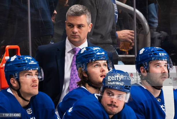 Sheldon Keefe head coach of the Toronto Maple Leafs watches from the bench agains the Buffalo Sabres during the third period at the Scotiabank Arena...
