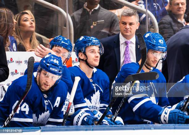Sheldon Keefe head coach of the Toronto Maple Leafs watches from the bench agains the Buffalo Sabres during the second period at the Scotiabank Arena...