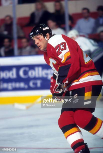 Sheldon Kennedy of the Calgary Flames skates on the ice during an NHL game against the Hartford Whalers on December 20 1995 at the Hartford Civic...