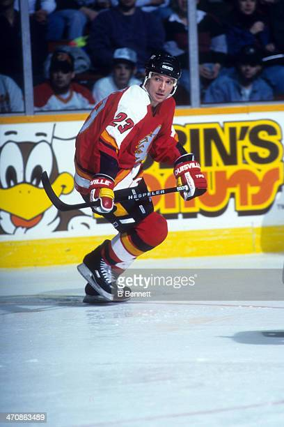 Sheldon Kennedy of the Calgary Flames skates on the ice during an NHL game against the Winnipeg Jets on March 5 1995 at the Winnipeg Arena in...
