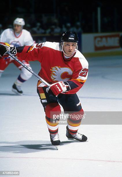 Sheldon Kennedy of the Calgary Flames skates on the ice during an NHL game against the Winnipeg Jets on January 20 1995 at the Winnipeg Arena in...
