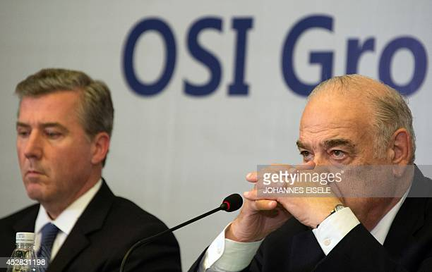 Sheldon Lavin CEO of the OSI Group and OSI president David McDonald attend a press conference over the recent expired meat scandal in Shanghai on...