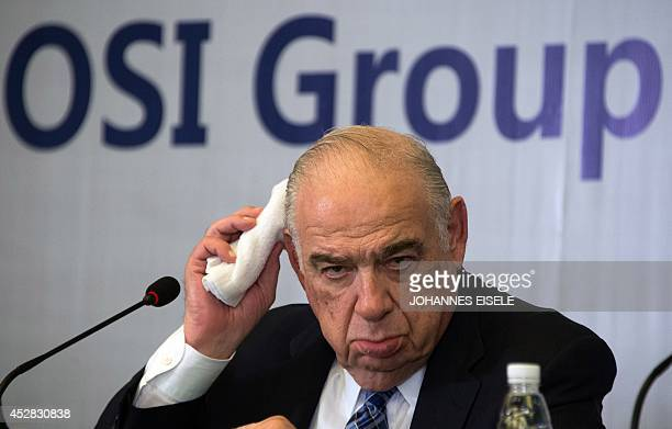 Sheldon Lavin CEO of the OSI Group gestures as he attends a press conference over the recent expired meat scandal in Shanghai on July 28 2014...
