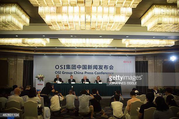 Sheldon Lavin CEO of the OSI Group heads a press conference with OSI executives over the recent expired meat scandal in Shanghai on July 28 2014...