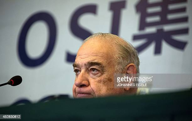 Sheldon Lavin CEO of the OSI Group reacts as he attends a press conference over the recent expired meat scandal in Shanghai on July 28 2014...