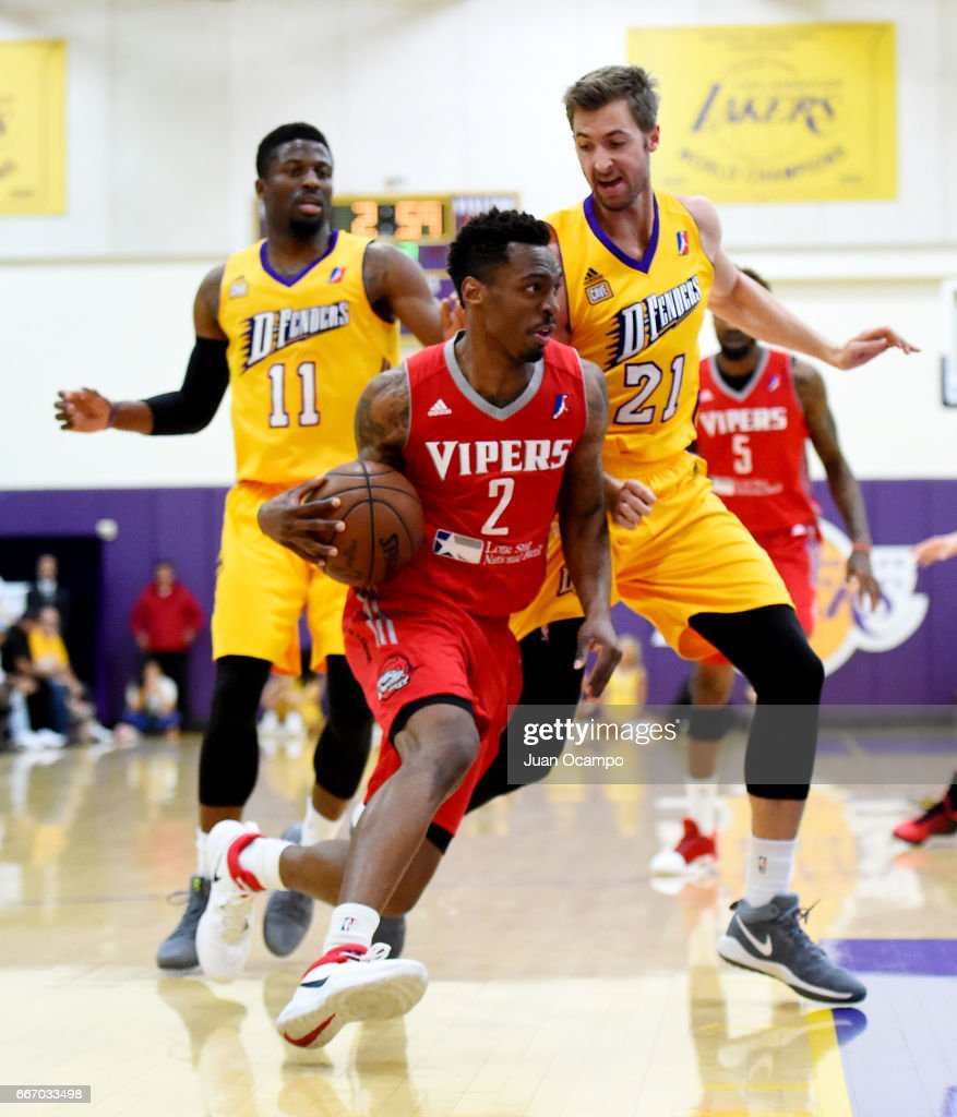 Sheldon McClennan #2 of the Rio Grande Vipers drives to the basket against Travis Wear #21 and David Nwaba #11 of the Los Angeles D-Fenders in Game Three of the Western Division SemiFinals on April 10, 2017 at Toyota Sports Center in El Segundo, California.
