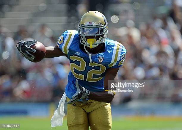 Sheldon Price of the UCLA Bruins carries the ball during the game against the Washington State Cougers at The Rose Bowl on October 2 2010 in Pasadena...