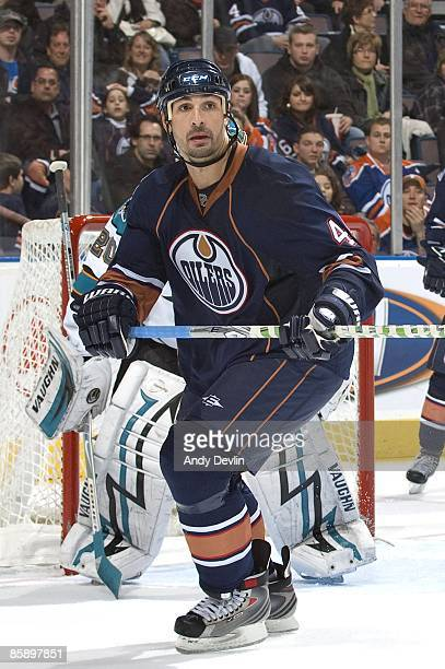 Sheldon Souray of the Edmonton Oilers keeps his eye on the puck against the San Jose Sharks at Rexall Place on April 2 2009 in Edmonton Alberta...
