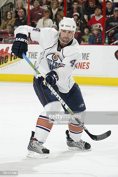 Sheldon Souray of the Edmonton Oilers passes the puck during the NHL game against the Carolina Hurricanes at RBC Center on January 18, 2008 in...