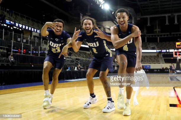 Sheldon Stevens, Kareem Thompson and Jamie Bergens of the Oral Roberts Golden Eagles celebrate after defeating the Florida Gators in the second round...