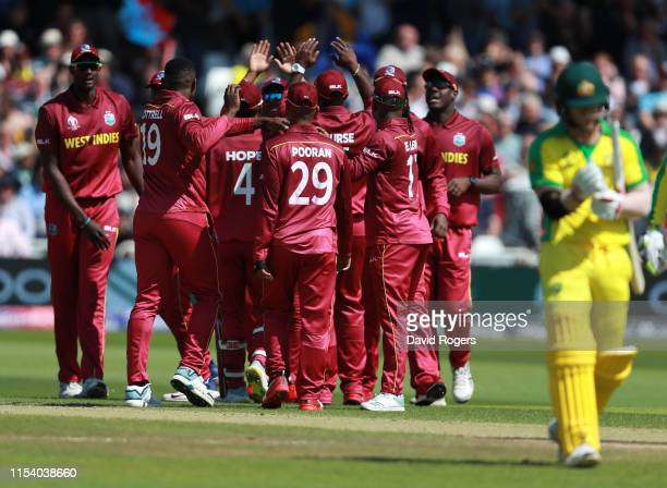 Sheldon Warner of the West Indies celebrates with team mates after taking the wicket of David Warner during the Group Stage match of the ICC Cricket...
