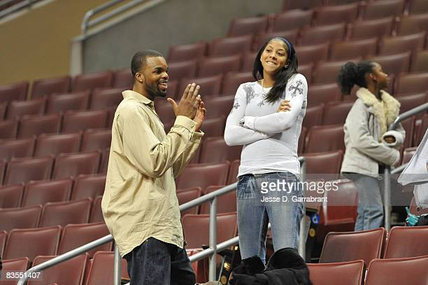 Sheldon Williams of the Sacramento Kings meets with his wife Candace Parker of the Los Angeles Sparks after the game against the Philadelphia 76ers...