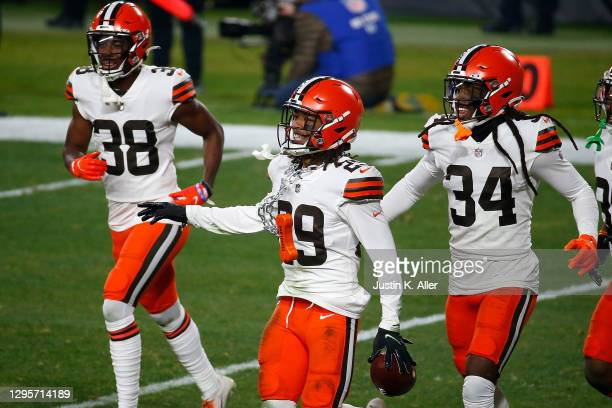 Sheldrick Redwine of the Cleveland Browns celebrates an interception during the first half of the AFC Wild Card Playoff game \ at Heinz Field on...