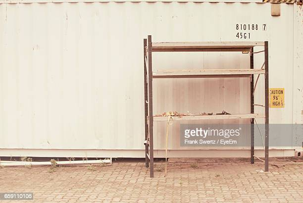 shelf against wall on footpath - frank swertz stock pictures, royalty-free photos & images