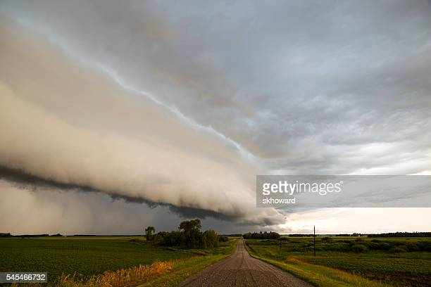 shelf cloud over country road - extreme weather stock photos and pictures