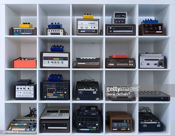 Shelf of drum machines