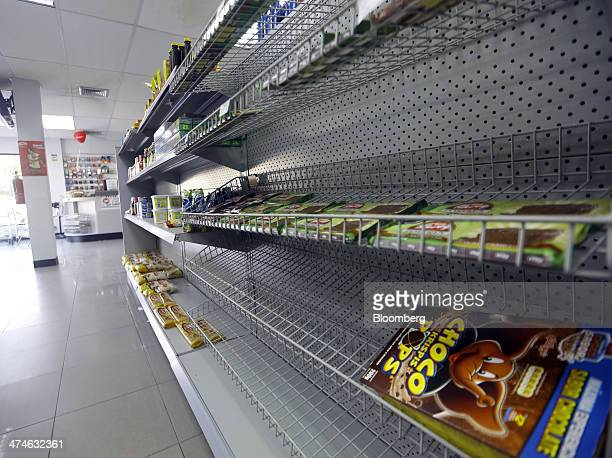 A shelf sits mostly bare of goods in a grocery store in Barcelona Venezuela on Friday Feb 21 2014 Antigovernment protests have intensified in...
