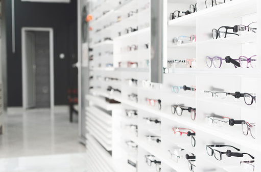 shelf with glasses in the shop 971086722