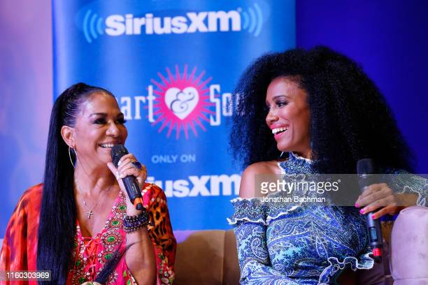 Shelia E and Essence chief content and creative officer MoAna Luu and Sheila E react during SiriusXM's Heart Soul Channel Broadcast from Essence...