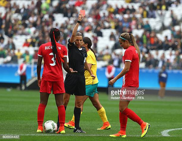Shelina Zadorsky of Canada is shown the red card by referee Stephanie Frappart during the Women's First Round Group F match between Canada and...