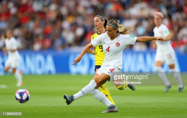 Shelina Zadorsky of Canada passes the ball under pressure from Kosovare Asllani of Sweden during the 2019 FIFA Women's World Cup France Round Of 16...