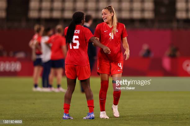 Shelina Zadorsky of Team Canada interacts with Nichelle Prince of Team Canada as they celebrate victory in the Women's Semi-Final match between USA...