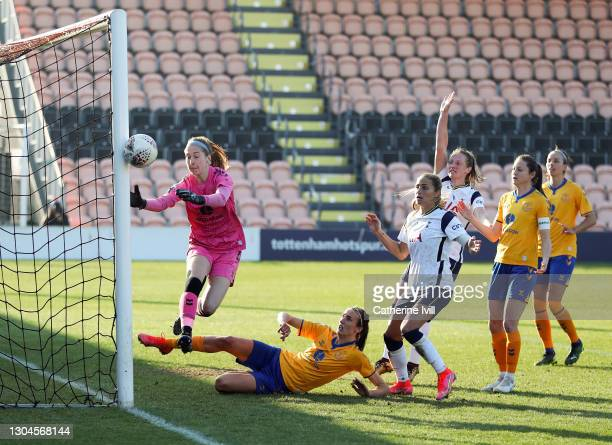Shelina Zadorsky of Tottenham Hotspur sees her shot hit the post and go wide as Sandy MacIver and Jill Scott of Everton defend during the Barclays FA...