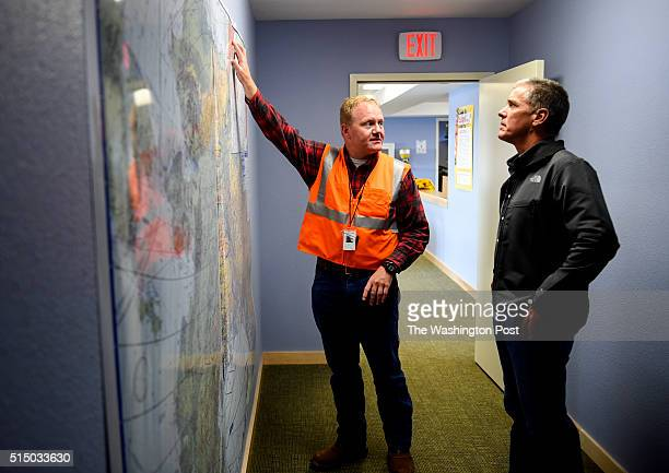 Shell Air terminal manger Jeff Vaughn shows President Marvin Odum the air routes to the Arctic offshore drilling rigs on September 2 2015 in Barrow AK