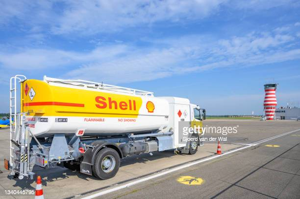 Shell aviation jet fuel truck at the tarmac of Lelystad airport with the air traffic control tower in the background on September 14, 2021 in...